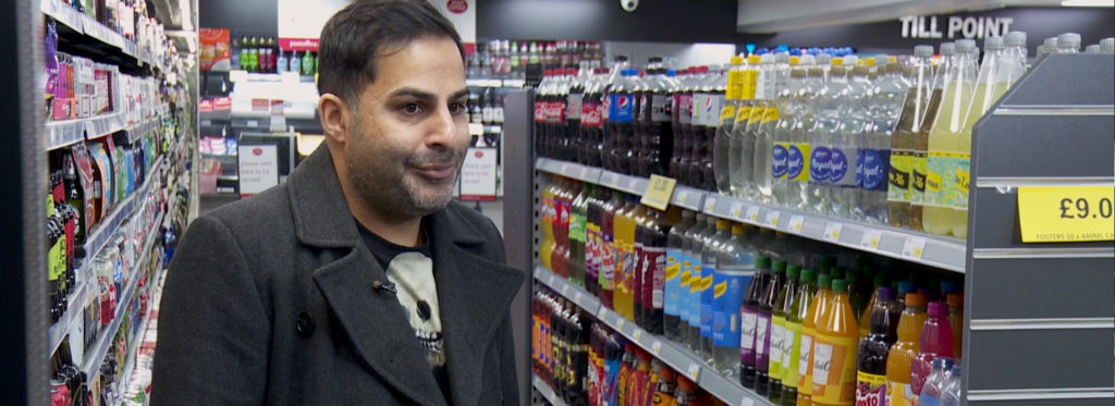 Man standing in a convenience store